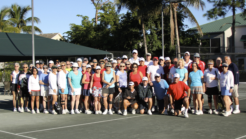 A tennis league poses for a picture at Tarpon Cove in Naples, Florida
